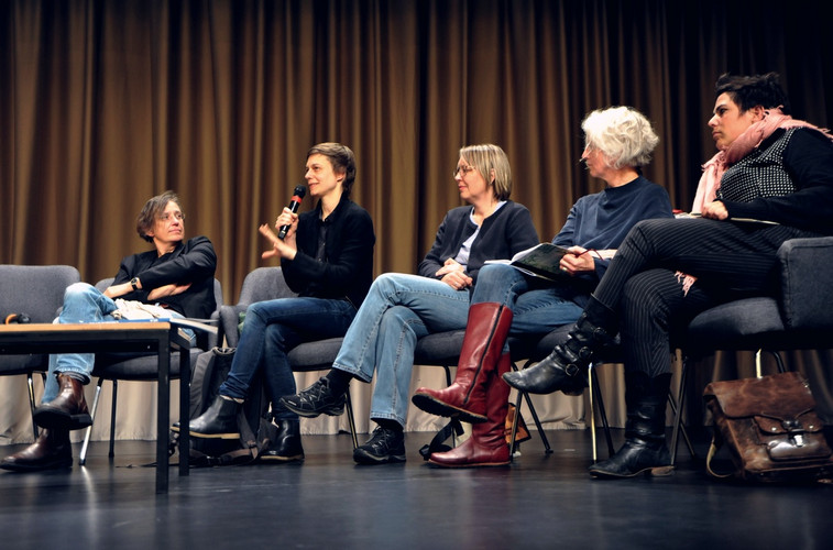 Conversation with five people on stage