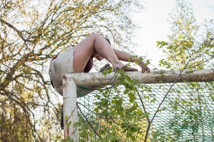 Woman climbs in nature.