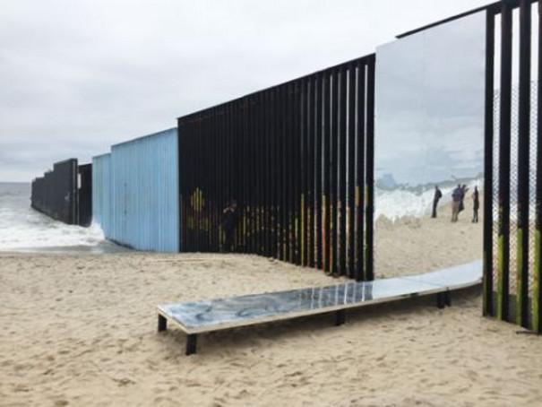 Mirror shams a gateway in the border.